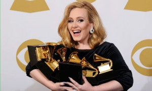 See?  I count exactly a bajillion and twelve awards in her arms here.