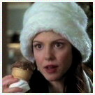 This is her in one of my favorite scenes from The West Wing.  Somehow she still looks good even wearing a ludicrous hat and eating an ice cream cone.